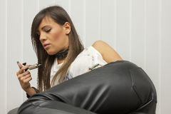 Beautiful professional tattoo master looking at the machine for tattoo 3 royalty free stock image