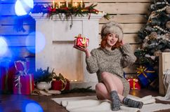 Beautiful sexy redhead girl in a New Year`s. Interior royalty free stock image