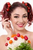 Beautiful redhead woman smiling and playing with hair, with royalty free stock images