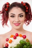 Beautiful redhead woman smiling with cherry tomatoes as scr stock image