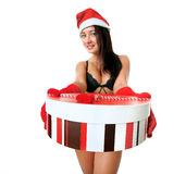 Beautiful and sexy Santa girl. With a gift in her hands Royalty Free Stock Image