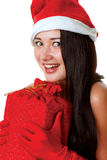 Beautiful and sexy Santa girl. With a gift in her hands Stock Photography