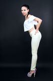 Beautiful sexy slim girl in trousers posing Royalty Free Stock Images