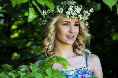 Beautiful sexy smiling girl with a wreath on his head in the spring park Stock Photography