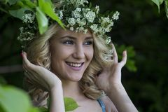 Beautiful sexy smiling girl with a wreath on his head in the spring park Stock Photos