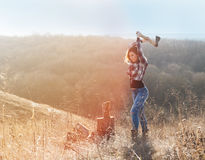 Beautiful sexy smiling woman chopping wood with axe Stock Photos
