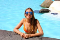 Beautiful sexy tanned girl with sunglasses and bikini relaxing in swimming pool in resort spa hotel on her travel holidays in. Tenerife royalty free stock images