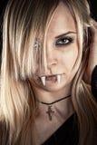 Beautiful vampire. With fangs stock image