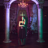 Beautiful and vampire in her mansion. Halloween Stock Photography