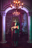 Beautiful and sexy vampire in her mansion. Halloween Royalty Free Stock Images