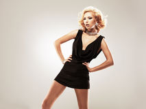 Beautiful sexy white woman in black dress Royalty Free Stock Photo