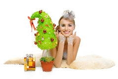 Beautiful sexy winter girl and Christmastree Stock Photography