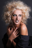 Beautiful and sexy witch with creative make up. And coiffure Royalty Free Stock Photography