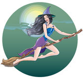 Beautiful sexy witch flying in the Halloween night on a broom through the night sky on the background of the moon and clouds Royalty Free Stock Photos