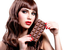 Beautiful sexy woman with bar of chocolate. Stock Image