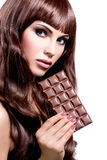 Beautiful sexy woman with bar of chocolate. Royalty Free Stock Photo