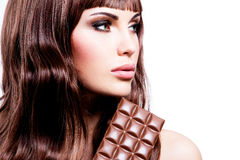 Beautiful sexy woman with bar of chocolate. Royalty Free Stock Photography