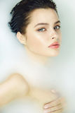 Beautiful sexy woman in bath with milk spa cosmetic body Royalty Free Stock Photos