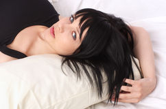 Beautiful woman in the bed Stock Photos