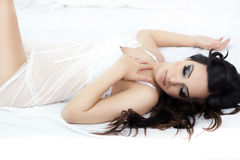 Beautiful woman in bed,eyes closed Royalty Free Stock Image