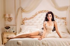 Beautiful and sexy woman  in bed Stock Photography