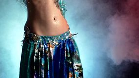 Beautiful sexy woman belly dancer in blue dress on stock video