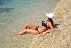 Beautiful sexy woman in bikini. Resting on beach Royalty Free Stock Photos