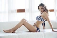 Beautiful and sexy woman in bikini and sweater Royalty Free Stock Image