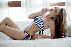 Beautiful and sexy woman in bikini and sweater Royalty Free Stock Photos
