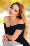 Beautiful sexy woman with black dress and blond hair outdoor. Fashion girl Royalty Free Stock Photos