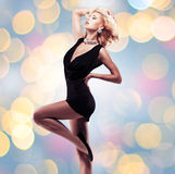 Beautiful woman in black dress stock images