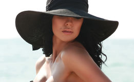 Beautiful sexy woman in black elegant hat Royalty Free Stock Photography