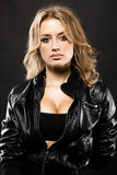 Beautiful sexy woman in black leather jacket Stock Photo