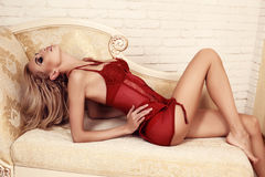 Beautiful sexy woman with blond hair in lace lingerie corset Royalty Free Stock Photo