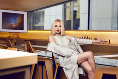 Beautiful sexy woman blond hair make up party coctail dress Royalty Free Stock Images