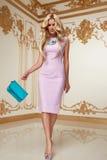 Beautiful woman blond hair pink evening dress acsessory