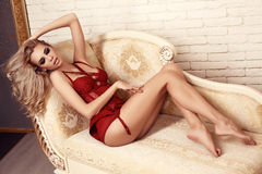 Beautiful sexy woman with blond hair in red lace lingerie Royalty Free Stock Photos