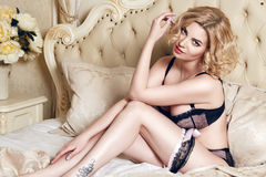 Beautiful sexy woman blond in lace lingerie makeup body shape Stock Photography