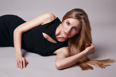 Beautiful sexy woman blonde hair evening make up casual dress. Beautiful young sexy woman with long blonde hair with natural make-up wearing short evening dress Royalty Free Stock Photos