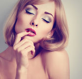 Beautiful sexy woman with bright eyes makeup touching her pink l Royalty Free Stock Photo