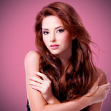 Beautiful woman with brown long hairs. Posing at studio royalty free stock photography