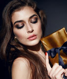 Beautiful sexy woman brunett evening makeup with box present Royalty Free Stock Image