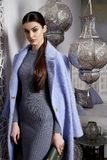 Beautiful sexy woman brunette hair east style arabic morocco. Furniture glamour model pose fashion clothes skinny wool cotton dress coat jacket accessory hand Royalty Free Stock Photography