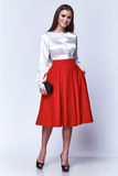 Beautiful woman brunette hair fashion model wear stylish casual collection glamour pose studio Stock Image