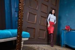 Beautiful sexy woman brunette hair wear skirt sweater Royalty Free Stock Photography