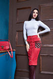 Beautiful sexy woman brunette hair wear skirt. Sweater fashion clothes  style for office lady trend accessory bag casual glamor natural makeup pretty face Stock Image