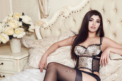 Beautiful sexy woman brunette in lace lingerie makeup body shape Royalty Free Stock Photo