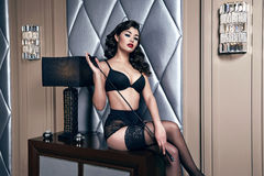Beautiful sexy woman brunette in lace lingerie makeup body shape Stock Photos