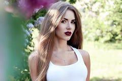 Beautiful sexy woman brunette walk in park sun shine dress Royalty Free Stock Photos