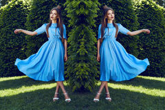 Beautiful sexy woman brunette walk in park sun shine dress Stock Images